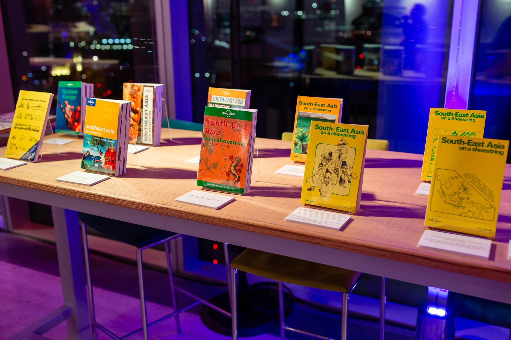 The many editions of South-East Asia on a shoestring on display at Lonely Planet's 45th birthday party in 2018 © Teofil Rewers Photography.