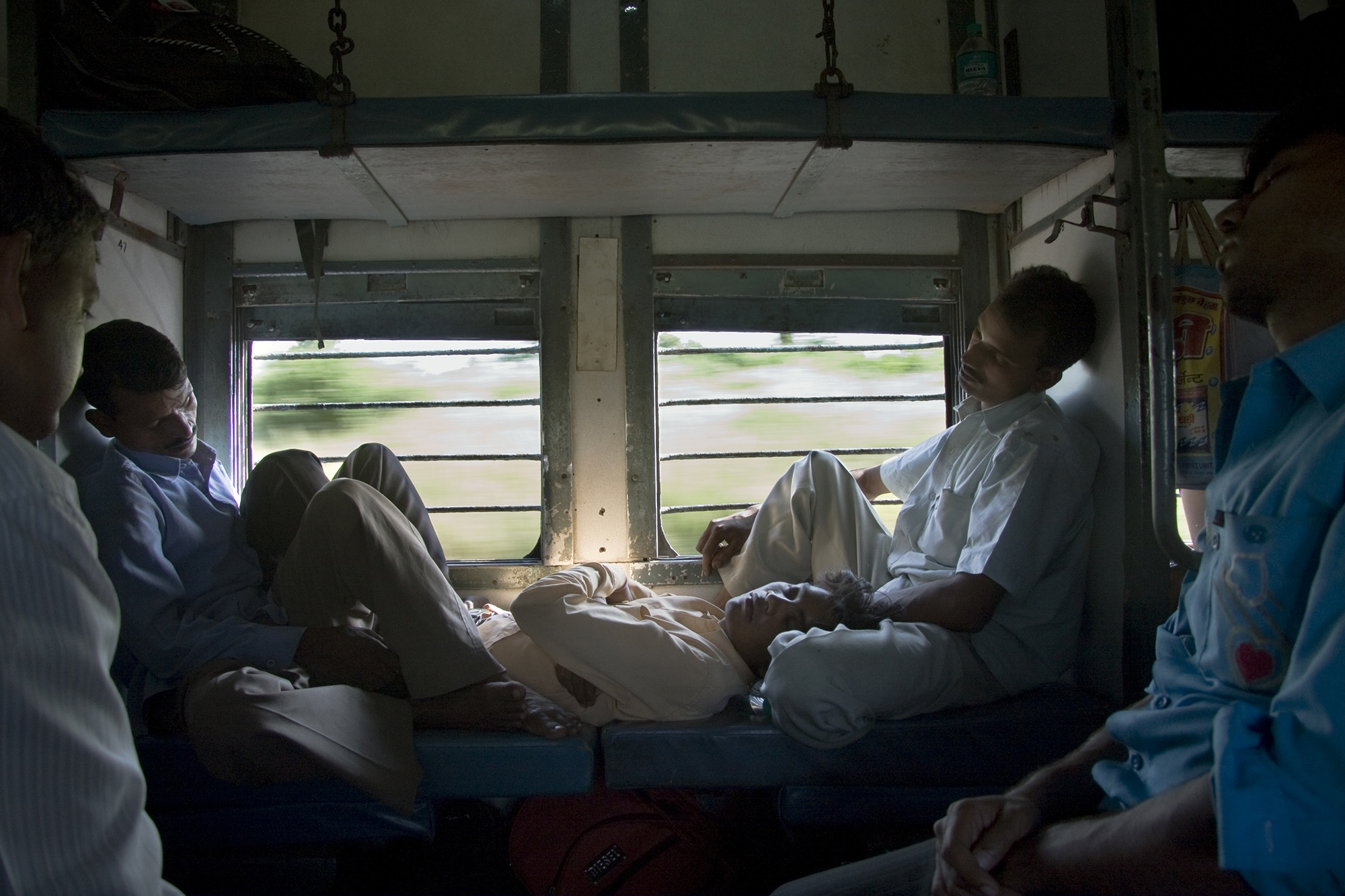 Passengers inside the carriage of a moving train, India