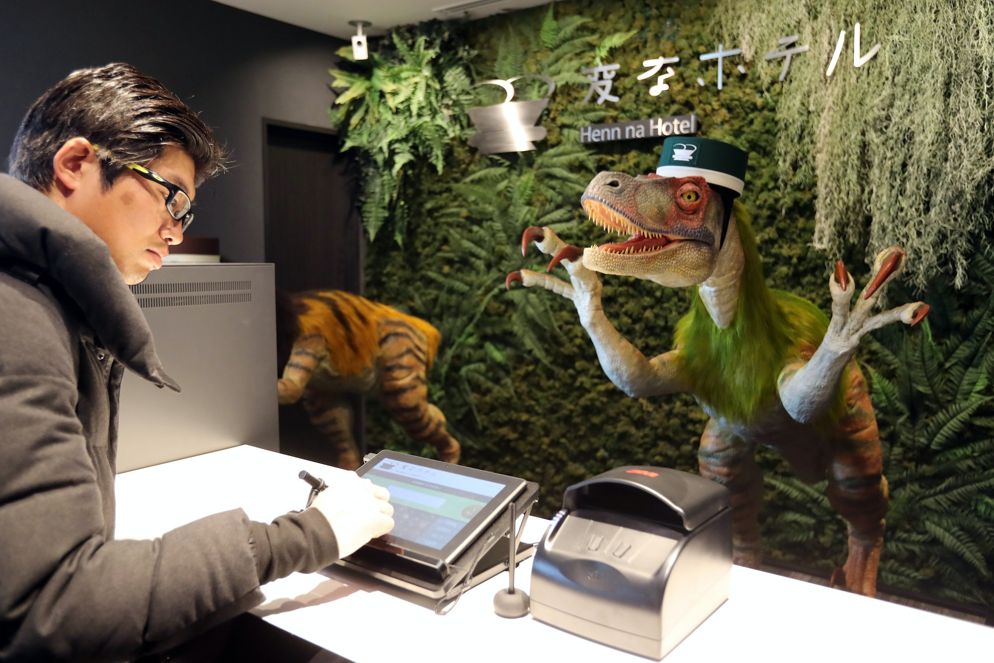 A dinosaur robot greets a guest at the Henn na Hotel, Japan