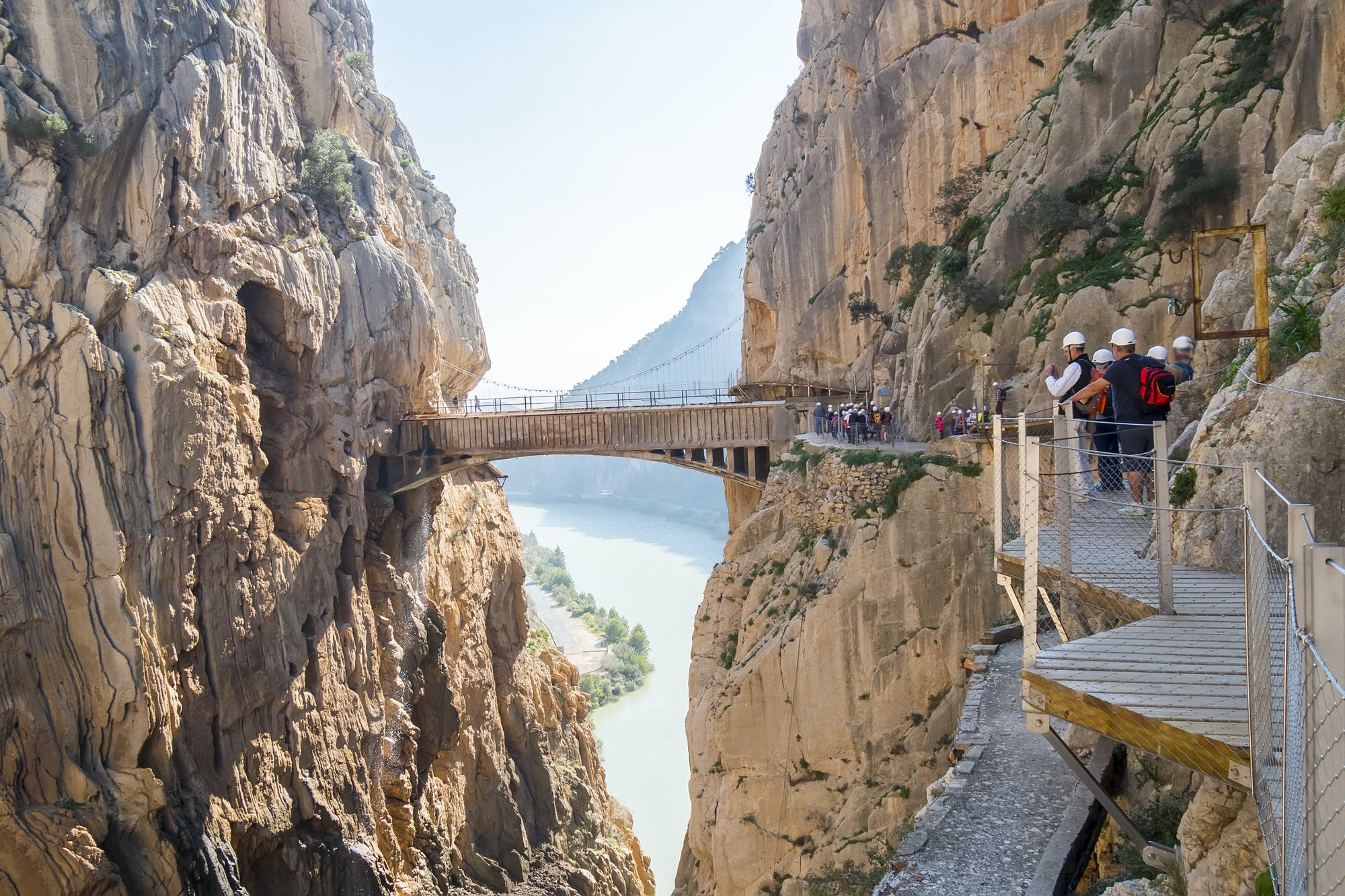 A section of the Caminito del Rey, a narrow wooden walkway protruding from a sheer rock face