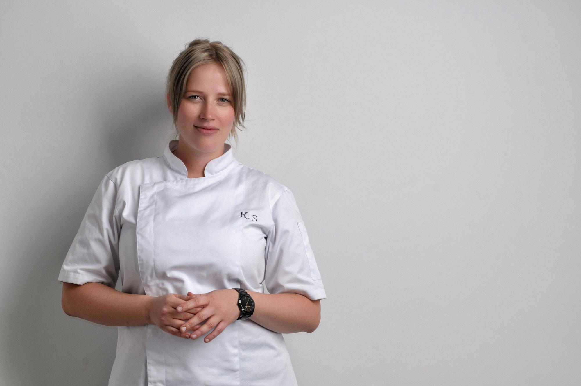 A portrait shot of Kamilla Seidler in a white apron