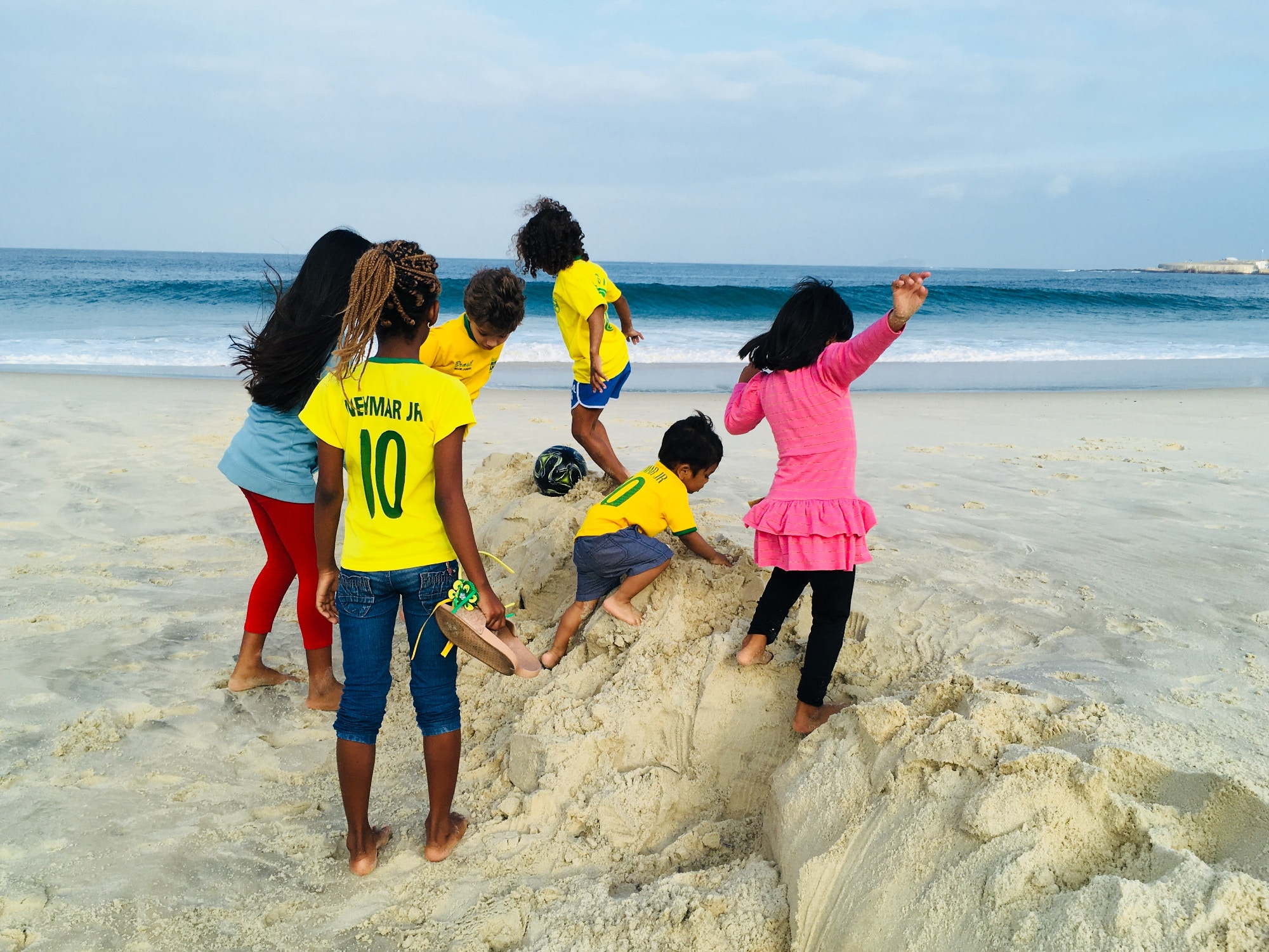 Samai's son playing with children on Copacabana beach, Rio de Janeiro