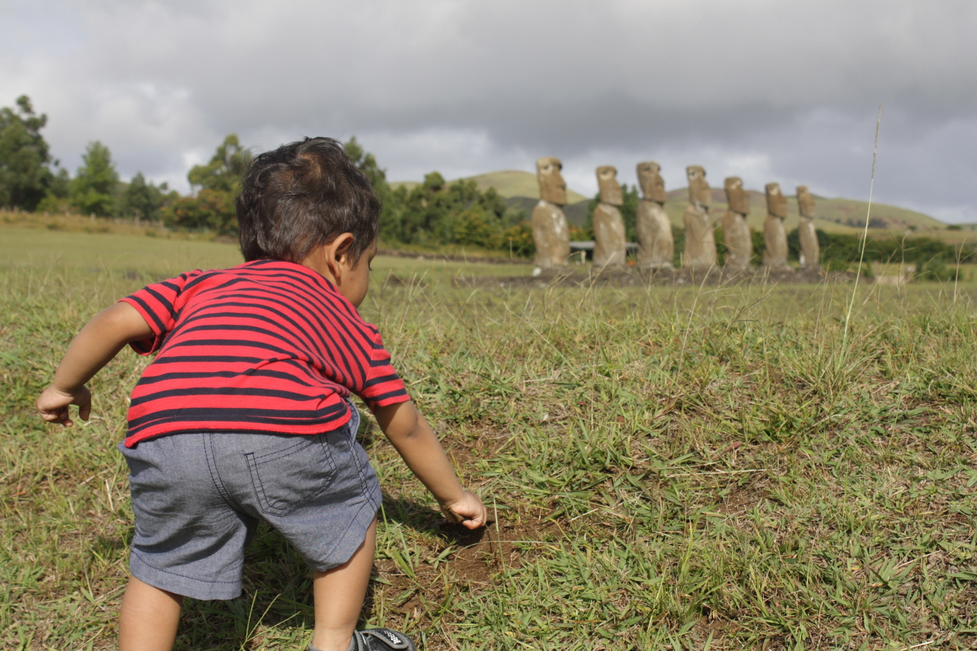 Samai's son trying to dig up more Moai on Easter Island