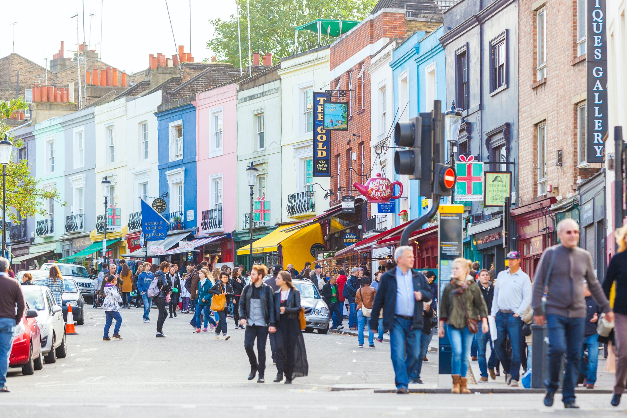 People stroll along London's Portobello Road, a famous market area in Notting Hill district