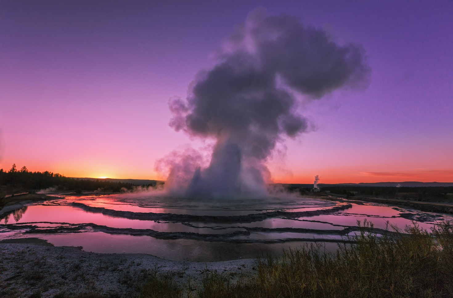 The unpredictable Great Fountain Geyser, in Yellowstone at sunset © Alex Mironyuk / 500px